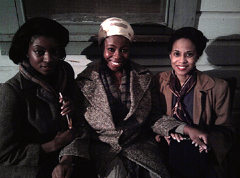 Three women on a bench (from left to right): LaFonda Baker, Omoze Idehenre, and Veronica Loud on set for the feature film On The Road.